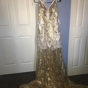 This a white and gold prom dress